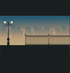 Street lamp with fence scenery silhouettes vector