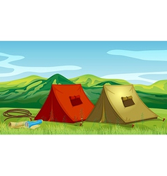 Camping tents near the mountain vector