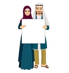 Emirati couple holding empty blank board vector image