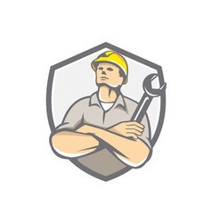 Builder arms crossed wrench shield retro vector