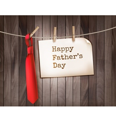Happy Fathers Day background with a red tie on a vector image