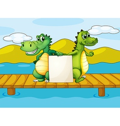 Two crocodiles holding an empty board vector image