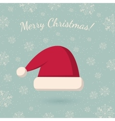 Christmas hat on winter backdrop vector