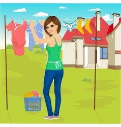 young woman hanging wet clothes out to dry vector image
