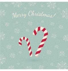 Christmas lollipops on winter backdrop vector image