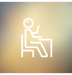Student sitting on a chair in front of his table vector