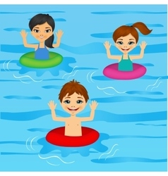 Three cute little kids swimming vector