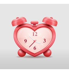 Alarm clock in heart shape vector