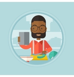 Man looking for salad recipe in tablet computer vector image