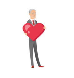 Caucasian businessman holding a big red heart vector