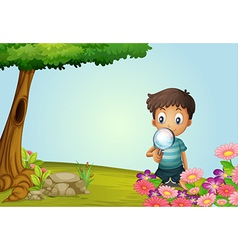 Boy with a magnifying glass vector image