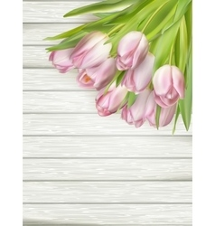 Pink Tulips over wooden table EPS 10 vector image vector image