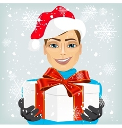 Young man wearing a santa hat offering gift vector image vector image