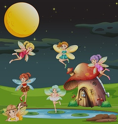 Fairies flying over the house at night vector