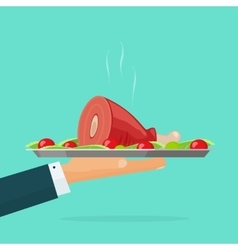 Hand holding serving tray with roasted meat hot vector