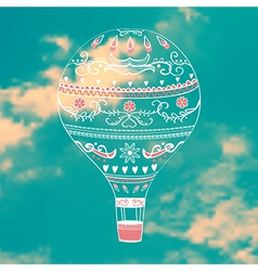 With decorative hot air ballon in blue sky vector