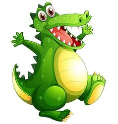 A playful green crocodile vector image