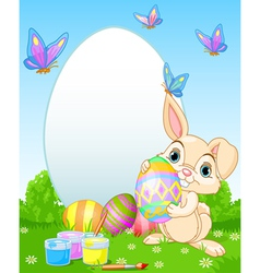 Easter bunny painting easter eggs vector