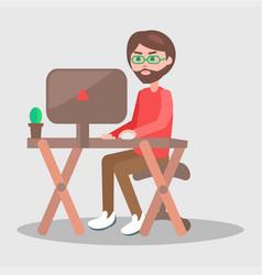 cartoon man sits at table with computer vector image