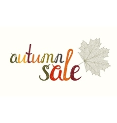 Autumn sale inscription with maple leaf vector