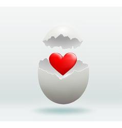 Red heart in the broken egg vector