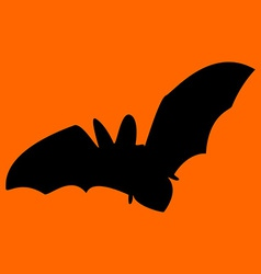 Silhouette of bat orange background vector image