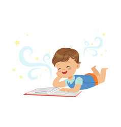 funny little boy lying and reading magic book with vector image vector image