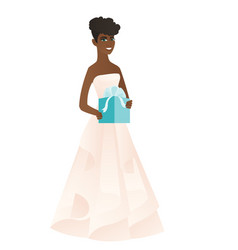 Woman in a white bridal dress holding a gift box vector