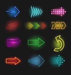realistic neon arrow on a dark background vector image vector image