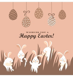 Easter bunnies and easter eggs vector image