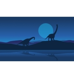 Silhouette of brachiosaurus on riverbank scenery vector