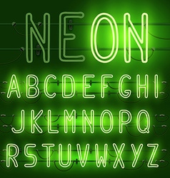 Set of realistic neon letters of the english vector