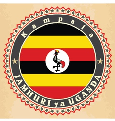 Vintage label cards of uganda flag vector