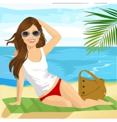 Brunette sunbathing on beach sitting on a towel vector