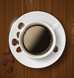 Cup of coffee and coffee beans on wooden table vector