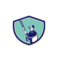 Hunter holding shotgun rifle crest retro vector