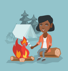 African girl roasting marshmallow over campfire vector