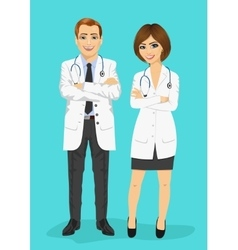 Male and female doctors standing with arms folded vector