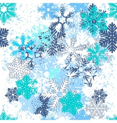 Seamless pattern with blue snowflakes vector