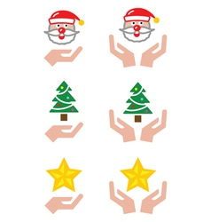 Hands with christmas icons - santa claus tree st vector
