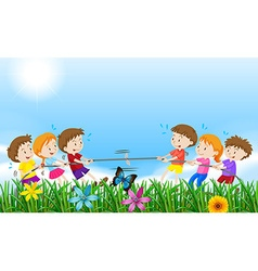 Children playing tug o war in the field vector image