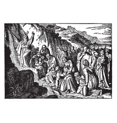 Moses strikes the rock and water flows in the vector