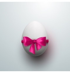 Easter egg with pink bow vector