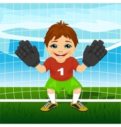 Young goalkeeper boy in a ready position vector