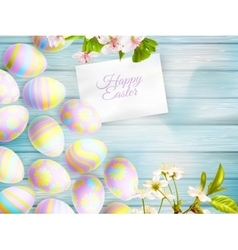 Easter eggs on the wooden table EPS 10 vector image