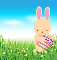 Rabbit and easter eggs on green grass vector
