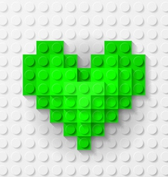 Green heart made of construction kit vector image