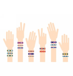 Hands with hippy friendship bracelets vector