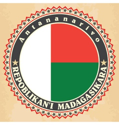 Vintage label cards of madagascar flag vector