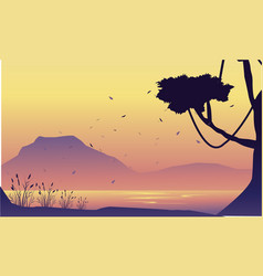 Silhouette of mountain and tree scenery vector
